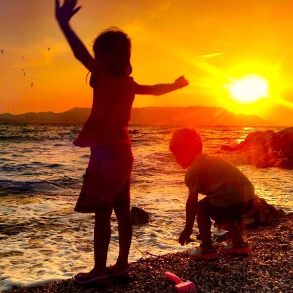 Croatia sunset: Kids playing at the beach