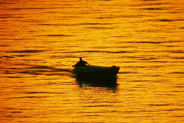 Croatia sunset: Fisherman at sunset