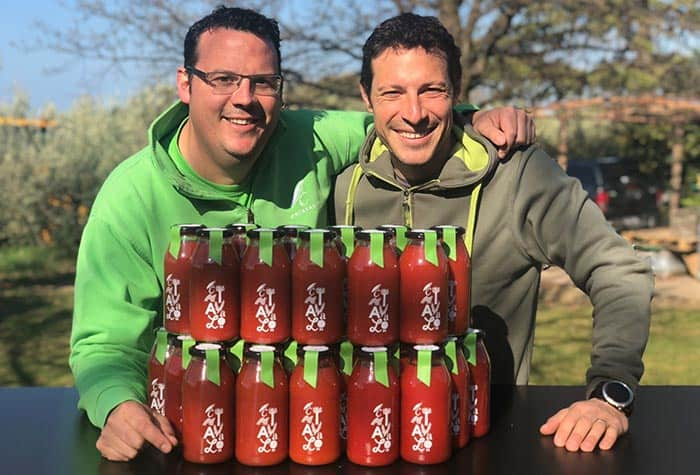 Photo of Chiavalon Olive Oil producers with their organic tomato sauce