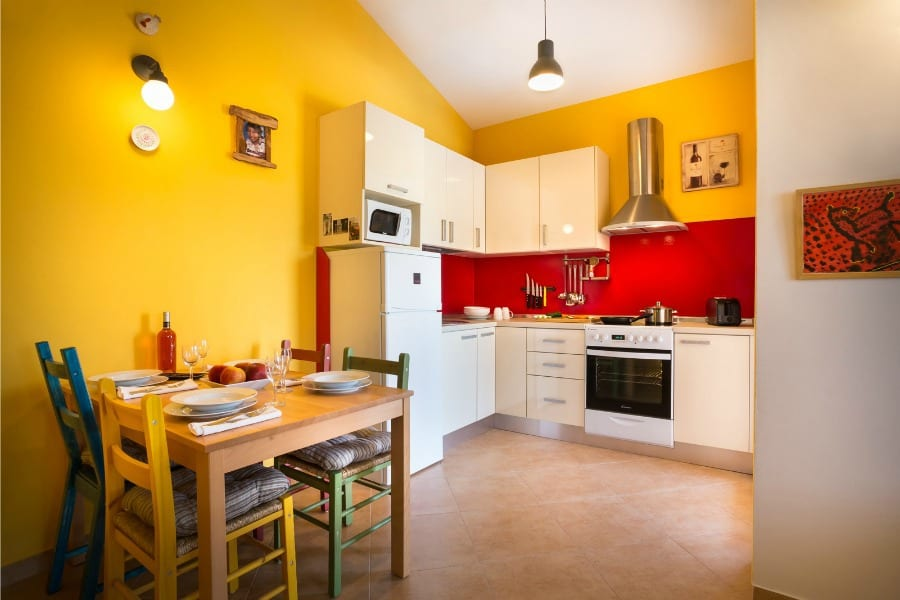 Frank's Place | A fully-equipped kitchen with a dining area for four persons