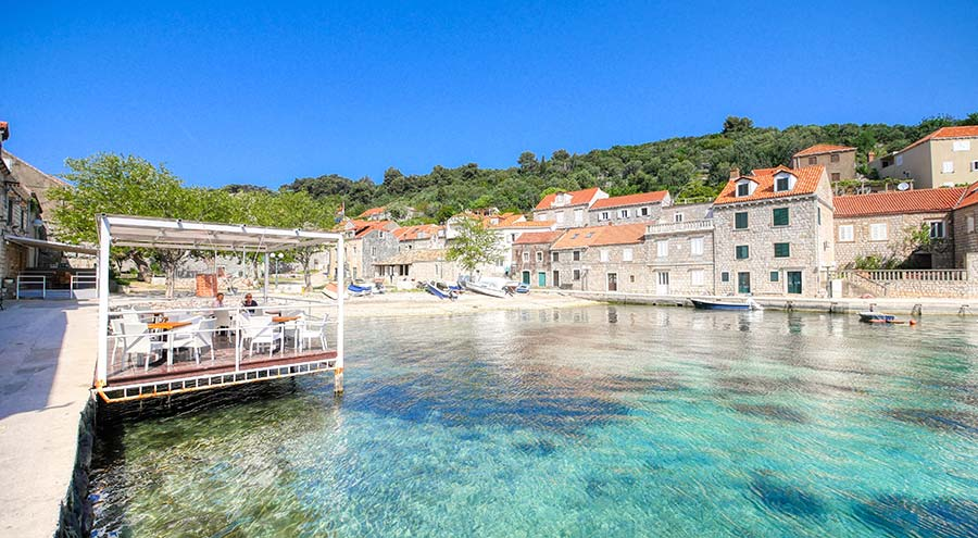 A beach and houses in Sudard on the island of Sipan near Dubrovnik