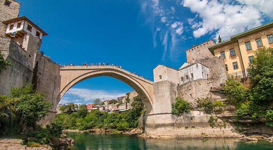 Mostar old bridge, river Neretva, houses