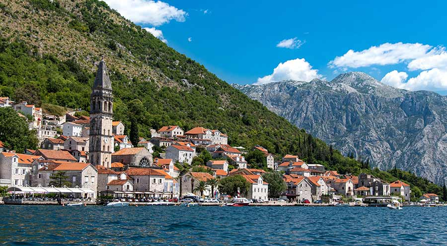 Houses, church and mountains in Perast, Kotor Bay, Montenegro, day trips from Dubrovnik