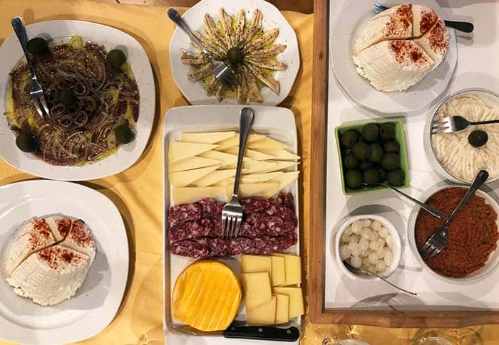 Food in Croatia | A plate of charcuterie, cheeses and marinated fish