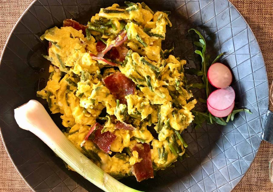 Fritaja, scrambled eggs with asparagus and prosciutto, typical dish in Istria